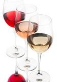 Vinho vermelho, cor-de-rosa e branco nos vidros Imagens de Stock