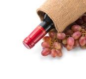 Vinho vermelho e uvas Imagem de Stock