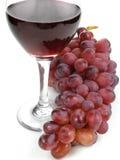 Vinho vermelho e uvas imagens de stock
