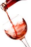 Vinho vermelho que derrama para baixo foto de stock