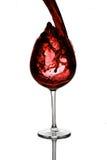 Vinho vermelho que derrama para baixo Imagem de Stock