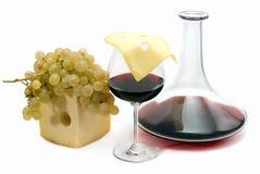 Vinho vermelho, uva e queijo Imagens de Stock Royalty Free