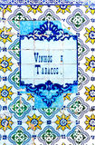 Vinhos e Tabacos. Part of an old Azulejos (tiles in Portugal Stock Photography