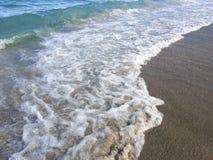 Vinka på stranden Arkivfoto