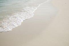 Vinka på stranden Arkivbilder