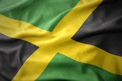Vinkande färgrik flagga av Jamaica Royaltyfria Bilder