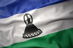 Vinkande färgrik flagga av Lesotho Royaltyfri Bild