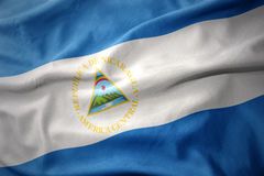 Vinkande färgrik flagga av Nicaragua Royaltyfri Bild