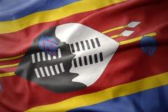 Vinkande färgrik flagga av Swaziland Arkivbilder