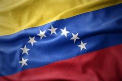 Vinkande färgrik flagga av Venezuela Royaltyfri Fotografi