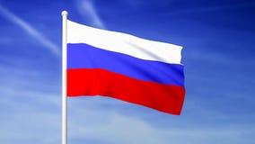 Vinkande flagga av Ryssland på bakgrunden för blå himmel
