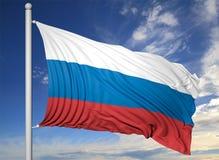 Vinkande flagga av Ryssland på flaggstång Fotografering för Bildbyråer