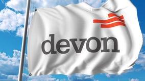 Vinkande flagga med den Devon Energy logoen Editoial 3D tolkning Arkivfoto