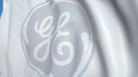 Vinkande flagga med den General Electric företagslogoen, närbild Redaktörs- loopable animering 3D stock video