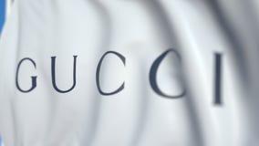 Vinkande flagga med den Gucci logoen, närbild Redaktörs- loopable animering 3D arkivfilmer