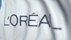 Vinkande flagga med L'Oreal S A logo närbild Redaktörs- loopable animering 3D stock illustrationer