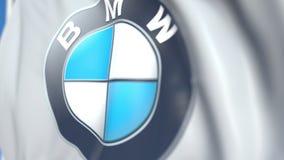 Vinkande flagga med logoen för BMW AG, närbild Redaktörs- loopable animering 3D stock video