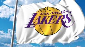 Vinkande flagga med Los Angeles Lakers yrkesmässig laglogo redaktörs- gem 4K arkivfilmer