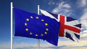 Vinkande flaggor av EU och UK på flaggstång Fotografering för Bildbyråer