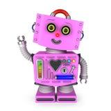 Vinkande hälsningar för leksakrobotflicka Royaltyfri Foto