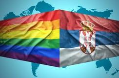 Vinkande serb- och bögflaggor fotografering för bildbyråer