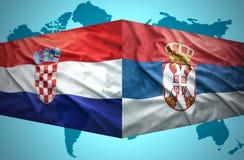 Vinkande serb- och kroatflaggor arkivfoton