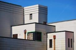 vinkelformig byggnad Arkivfoto