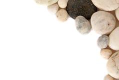 Vinkelgräns av stenar på vit bakgrund royaltyfria bilder