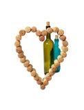 Vinkorkar i form av hjärta Arkivbilder