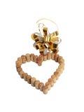 Vinkorkar i form av hjärta och en guld- pilbåge Royaltyfria Bilder