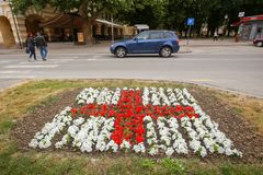 Red cross sign made from flowers. VINKOVCI, CROATIA - MAY 14, 2018 : A red cross sign made from flowers set up in front of the red cross building in Vinkovci Royalty Free Stock Photography