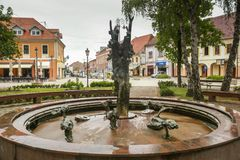 Vinkovci town in Croatia. VINKOVCI, CROATIA - MAY 14, 2018 : Water fountain in the city park in city center of Vinkovci, Croatia stock images