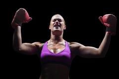 Vinnande kvinnabifall med lyftta armar Arkivbilder