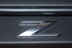 Vinnitsa, Ucrania - 24 de abril de 2012 Coche del concepto de Logo Nissan 350Z Imágenes de archivo libres de regalías