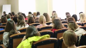 Classmates Sitting In Classroom During Lecture stock footage