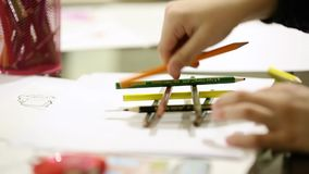 Kids Drawing With Colored Pencils stock video footage