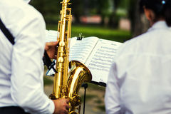 Vinnitsa,Ukraine - 23 August,2016.Gold saxophone with specks on. It in male hands.The musical collective plays a concert,jazz music concept Royalty Free Stock Image