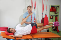 Physiotherapy: Exercise under supervision of physiotherapist. Treatment of pain in the spine w. VINNITSA, UKRAINE, AUGUST 15, 2017: Physiotherapy: Exercise under Royalty Free Stock Photos
