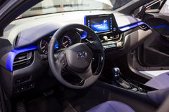 Vinnitsa, Ukraine - December 16, 2016.Toyota C-HR concept car.In. Side the car,steering wheel,interior of the car, logo Toyota, showroom.Presentation of the new Stock Photography