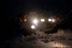 Vinnitsa, Ukraine - February 23, 2012. Hummer H1 in snowdrifts ,. In the snow,Black American off road, tuning, car photo session, a large jeep off road Stock Photo
