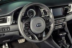 Vinnitsa, Ukraine - February 19, 2017.KIA Niro concept car.Insid. E the car,steering wheel,interior of the carFront of the car, logo KIA Niro,logo ECO hybrid Stock Photography