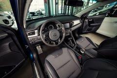 Vinnitsa, Ukraine - February 19, 2017.KIA Niro concept car.Insid. E the car,steering wheel,interior of the car, logo KIA Niro,logo ECO hybrid, showroom Stock Photography