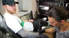Tattoo artist make tattoo at the studio. stock video footage