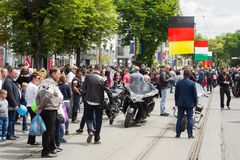 People consider motorcycles, during the rally of bikers, at the celebration of Europe Day stock photography