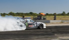 Rider Dmytro Illyuk  on the car brand Nissan overcomes the track Stock Photography