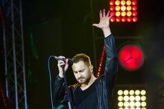 Vinnytsia, Ukraine - 13.10.2018: Oleh Sobchuk, frontman of Ukrainian pop-rock group SKAI, stands in spectacular poe. Vinnytsia, Ukraine - 13.10.2018: Oleh royalty free stock images