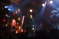 Oleh Sobchuk, Ukrainian pop-rock group SKAI lead singer , sings in spectacular pose at Roshen Fountain Season closing concert. Vinnytsia, Ukraine - 13.10.2018 stock photos