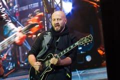 Vinnytsia, Ukraine - 13.10.2018: Oleksandr Hryshchuk, lead guitarist of Ukrainian pop-rock group SKAI, plays Gibson solo guitar. At Roshen Fountain Season royalty free stock image