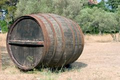 Vino by the barrel. Large wine barrel used for promotional purposes rather than storage. It could also be shelter for a homeless person Stock Photos