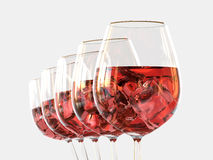 Vino bianco in un vetro con ghiaccio Immagini Stock